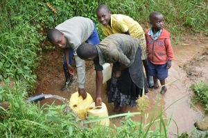 The Water Project:  Collecting Water From Shisia Spring