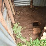 The Water Project: Maraba Community, Shisia Spring -  Mud Floor Of Latrine