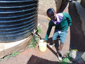 The Water Project:  Pupils Fetching Water At Home