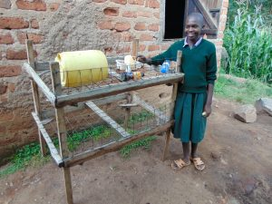 The Water Project:  Student Choosing A Cup From The Dishrack