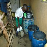 The Water Project: Kitambazi Primary School -  Fetching Water From Home To Take To School