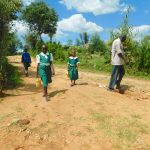 The Water Project: Kitambazi Primary School -  Students Bring Water From Home After The Lunch Break