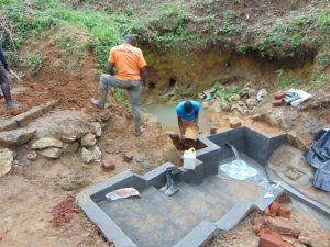 The Water Project:  Clay Works Ongoing To Seal Escape Channels