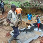 The Water Project: Mahira Community, Wora Spring -  Ferrying Rocks For Backfilling