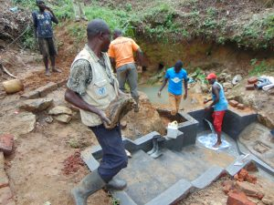 The Water Project:  Ferrying Rocks For Backfilling