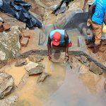 The Water Project: Mahira Community, Wora Spring -  Laying Stones