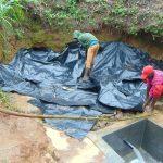 The Water Project: Mahira Community, Wora Spring -  Laying Polythene Membrane