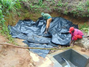 The Water Project:  Laying Polythene Membrane