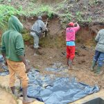 The Water Project: Mahira Community, Wora Spring -  Artisan Leads Soil Backfilling