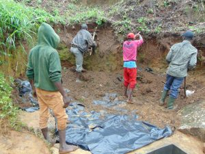 The Water Project:  Artisan Leads Soil Backfilling