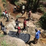 The Water Project: Mahira Community, Wora Spring -  Community Members Help Out