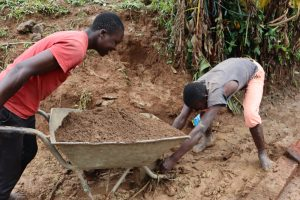 The Water Project:  Community Members Bring Materials To Site