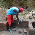 The Water Project: Mahira Community, Wora Spring -  Pipe Setting