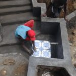 The Water Project: Mahira Community, Wora Spring -  Tile Setting