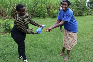 The Water Project:  Catherine Sanitizes Participants Hands