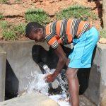 The Water Project: Mahira Community, Wora Spring -  Enjoying Water