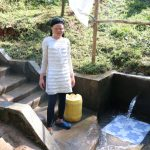 The Water Project: Mahira Community, Wora Spring -  Michelle Drawing Water From Wora Spring
