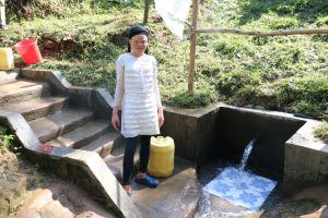 The Water Project:  Michelle Drawing Water From Wora Spring