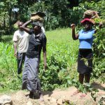The Water Project: Litinye Community, Shivina Spring -  Carrying Stones To Construction Site