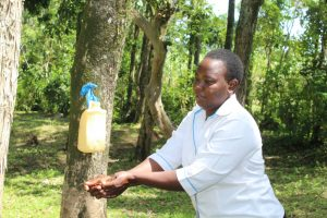 The Water Project:  Trainer Betty Demonstrates Handwashing
