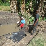 The Water Project: Litinye Community, Shivina Spring -  Laying Foundation