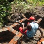 The Water Project: Litinye Community, Shivina Spring -  Pipe Setting