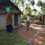 The Water Project: Machemo Community, Boaz Mukulo Spring -  Arriving Home With Water