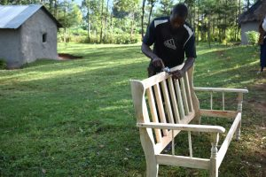 The Water Project:  Boaz Planing A Bench
