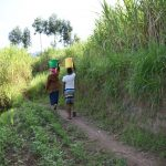 The Water Project: Machemo Community, Boaz Mukulo Spring -  Carrying Water
