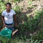 The Water Project: Machemo Community, Boaz Mukulo Spring -  Collecting Water