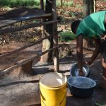 The Water Project: Machemo Community, Boaz Mukulo Spring -  Woman Washing Utensils