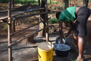 The Water Project:  Woman Washing Utensils