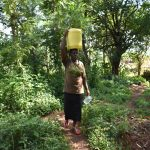 The Water Project: Kimang'eti Community, Kimang'eti Spring -  Agnes Carrying Water