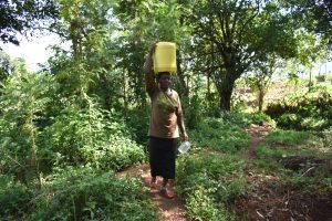 The Water Project:  Agnes Carrying Water