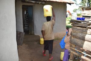 The Water Project:  Agnes Arriving Home With Water