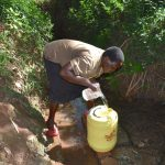 The Water Project: Kimang'eti Community, Kimang'eti Spring -  Agnes Fetching Water