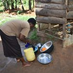 The Water Project: Kimang'eti Community, Kimang'eti Spring -  Agnes Washing Dishes