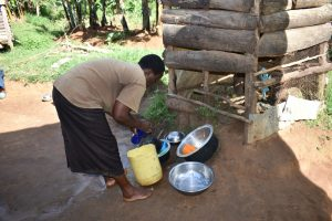 The Water Project:  Agnes Washing Dishes