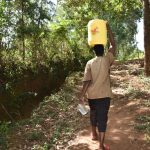 The Water Project: Kimang'eti Community, Kimang'eti Spring -  Carrying Water