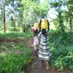 The Water Project: Kimang'eti Community, Kimang'eti Spring -  Girls Carrying Water