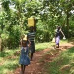 The Water Project: Imbiakalo Community, Askari Spring -  Carrying Water