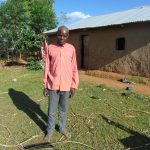 The Water Project: Indulusia Community, Osanya Spring -  A Community Member Outside His Home