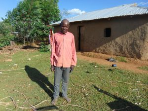 The Water Project:  A Community Member Outside His Home