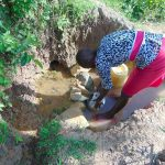 The Water Project: Indulusia Community, Osanya Spring -  Lillian Collecting Water