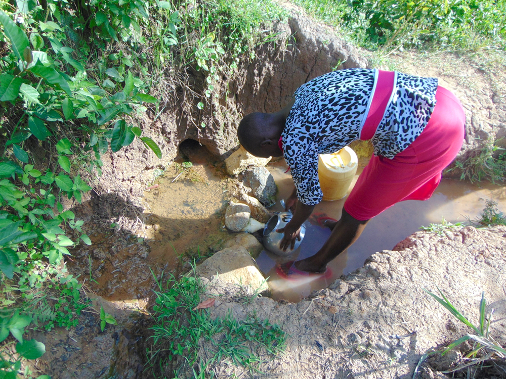 The Water Project : kenya20193-lillian-collecting-water-4