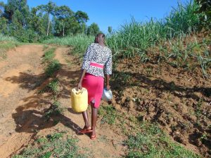 The Water Project:  Lillian Carrying Water Home