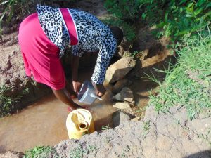 The Water Project:  Rinsing Out Her Teapot Before Fetching
