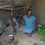 The Water Project: Indulusia Community, Osanya Spring -  At The Stove In The Kitchen