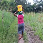 The Water Project: Makhwabuyu Community, Sayia Spring -  Carrying Water