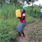 The Water Project: Makhwabuyu Community, Sayia Spring -  Mounting Water On Her Head